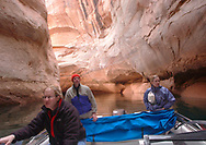 Cruising through the Cathedral in the Desert formation inside Clear Creek Canyon,  a side canyon in Lake Powell.  Thought by many to be the most spectacular side canyon in the former Glen Canyon, it had a waterfall, lush vegetation and towering, curving walls that made one feel a spiritual presence was in the place.  Because the lake level has dropped nearly 90 feet much of the side canyon is being exposed and now allows for small boats to enter the narrow passageway.<br /> Saturday, March 15, 2003.