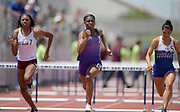 Asjah Atkinson of St. Anthony (center) wins the girls 100m hurdles in 14.08 during the 2019 CIF Southern Section Masters Meet in Torrance, Calif., Saturday, May 18, 2019.