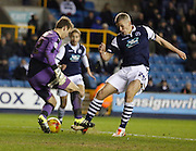 Millwall FC Forward Steve Morison (C) closes down Colchester FC Goalkeeper Jamie Jones during the Sky Bet League 1 match between Millwall and Colchester United at The Den, London, England on 21 November 2015. Photo by Andy Walter.