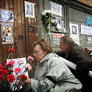Mourners gather to pay tribute to Russian journalist Anna Politkovskaya, murdered in Moscow on 7 October, 2006. She was shot twice, once in the head, in an elevator in her apartment block. .Known for her critical coverage of the war in Chechnya, she was shot to death in the elevator of her apartment building in Moscow, in a killing prosecutors believe could be connected to her investigative work..Politkovskaya was a tireless reporter who had written a critical book on Russian President Vladimir Putin and his campaign in Chechnya, documenting widespread abuse of civilians by government troops..Prosecutors have opend a murder investigation into her death, said Svetlana Petrenko, spokeswoman for the Moscow prosecutor's Office. Investigators suspect the killing was connected to the work of the 48-year-old journalist, Vyacheslav Raskinsky, Moscow's first deputy prosecutor said on state-run Rossiya television.