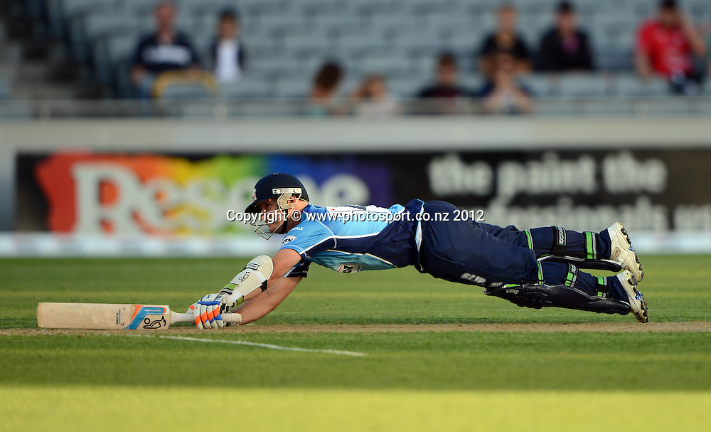 Gareth Hopkins slides in to make his ground during the HRV Cup Twenty20 Cricket match between Auckland Aces and Canterbury Wizards at Eden Park on Friday 21 December 2012. Photo: Andrew Cornaga/Photosport.co.nz