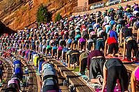 """Yoga on the Rocks""; 2000 people doing yoga together at Red Rocks Amphitheatre, Morrison (Denver), Colorado USA."