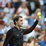 2017 U.S. Open Tennis Tournament - DAY FOUR. Roger Federer of Switzerland hits balls into the crowd after his victory against Mikhail Youzhny of Russia during the Men's Singles round two match at the US Open Tennis Tournament at the USTA Billie Jean King National Tennis Center on August 31, 2017 in Flushing, Queens, New York City. (Photo by Tim Clayton/Corbis via Getty Images)