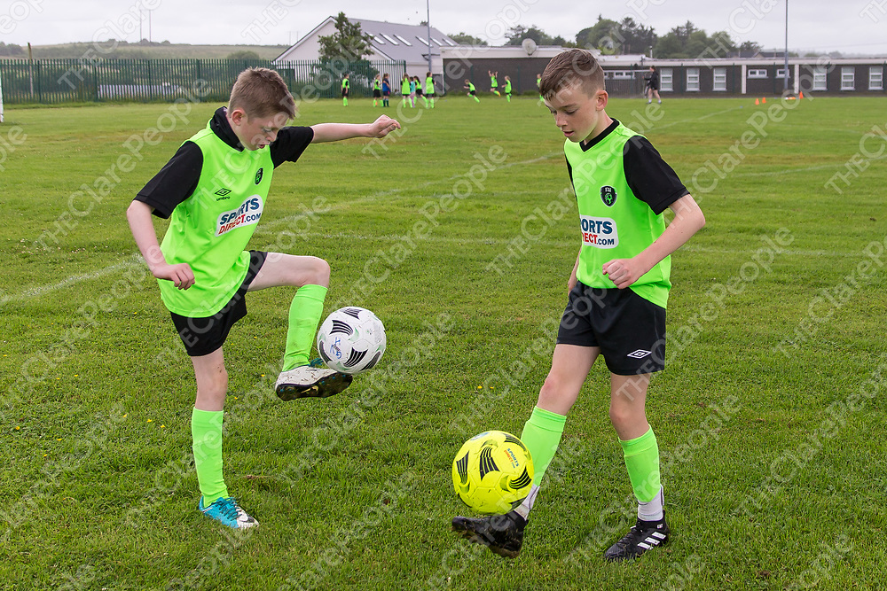 Evan Courtney from Kilmaley and Evan Monaghan from Connolly practicing their skills at the FAI Soccer Summer camp in Kilmaley 2017