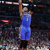 21 December 2015: Oklahoma City Thunder guard Russell Westbrook (0) goes for the dunk during the Oklahoma City Thunder 100-99 victory over the Los Angeles Clippers, at the Staples Center, Los Angeles, California, USA.