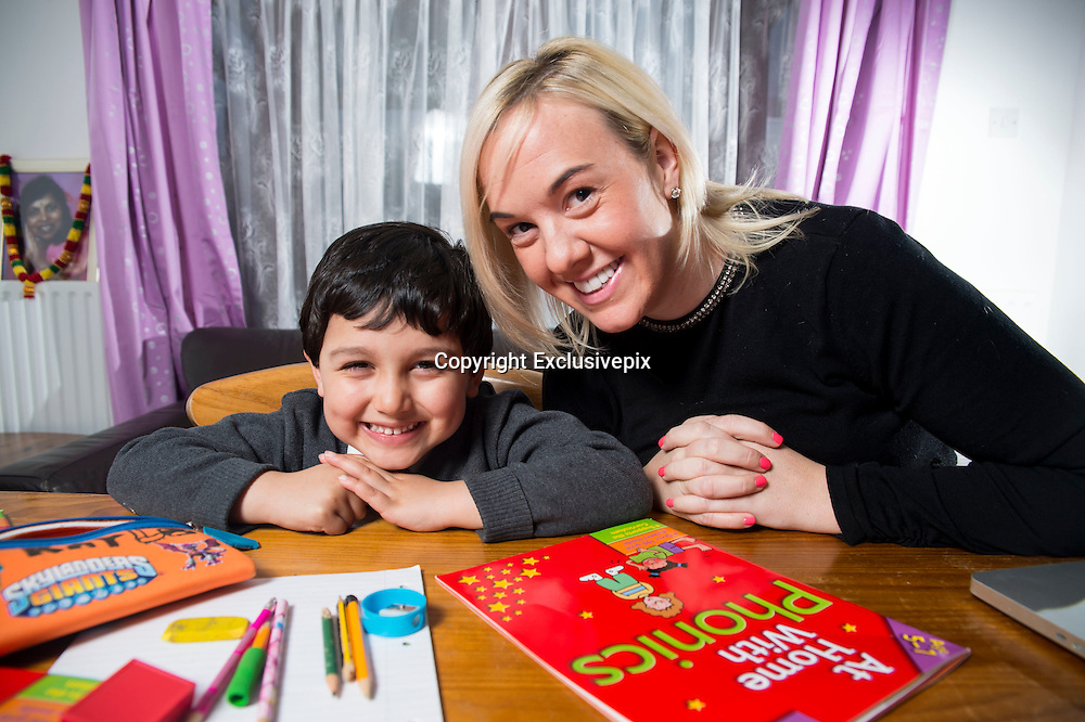 EXCLUSIVE - UK's youngest tutored child  jaayen, 4 years old, is tutored 13 hours a week and has homework of 3 hours a day, mum Tj ray and dad marcus ray, say they stand by there child being tutored because of the state of the schools and dont feel there pushed enough <br /> in class<br /> Photo shows: jaayen and his tutor stephanie williams of S6 Tutoring<br /> &copy;Exclusivepix