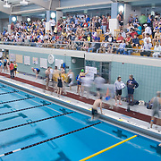 Spectators file into the stands as athletes complete their warm ups.
