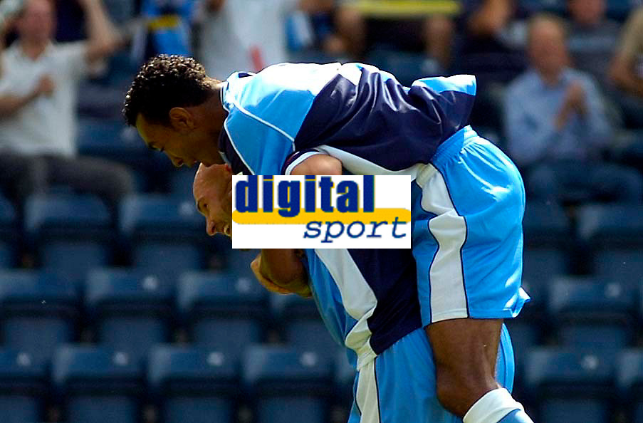 Photo: Alan Crowhurst.<br />Wycombe Wanderers v Wrexham. Coca Cola League 2.<br />05/08/2006. Wycombe's Tommy Mooney (L) is congratulated on his goal.