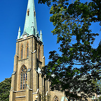 Haga Kyrka or Haga Church in Gothenburg, Sweden <br /> Plans to build the New Church started in the 1840s but Hagakyrkan was not finished until 1859.  A big part of the delay was the lack of funds until David Carnegie Jr., a Scottish brewer who ran a successful mill in Gothenburg, made a large donation. This neo-gothic structure with its impressive bell tower is capped by a green copper spire. Haga Kyrka looms large over the Haga neighborhood.