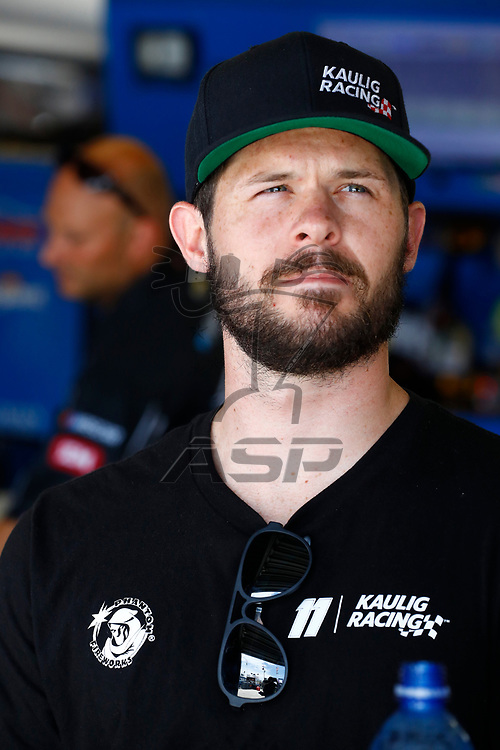 Ryan Truex (11) hangs out in the garage during practice for the Coca-Cola Firecracker 250 at Daytona International Speedway in Daytona Beach, Florida.