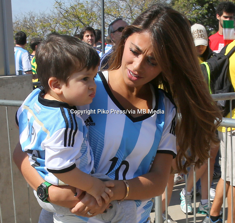 Fifa Soccer World Cup - Brazil 2014 - <br /> ARGENTINA TEAM -<br />  Lionel Messi wife ANTONELLA ROCCUZZO with their little son THIAGO arriving to the Stadium Estadio Mineirao for the Match Argentina (1) Vs IRAN (0) <br /> Messi did the goal , and dedicate it to his son THIAGO <br />  - Belo Horizonte - Brazil (BRA) - 22 Jun 2014 <br /> &copy; PikoPress