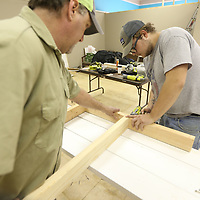 Mike Eleopoulos Jr., and dad Mike Sr., building framing for wall extensions at the Autsim Center of North Mississippi's new space. The Autism Center has received a grant to fund to renovations to allow them to start a new program aimed at daily living, pre-vocational and social skills for people with autism.
