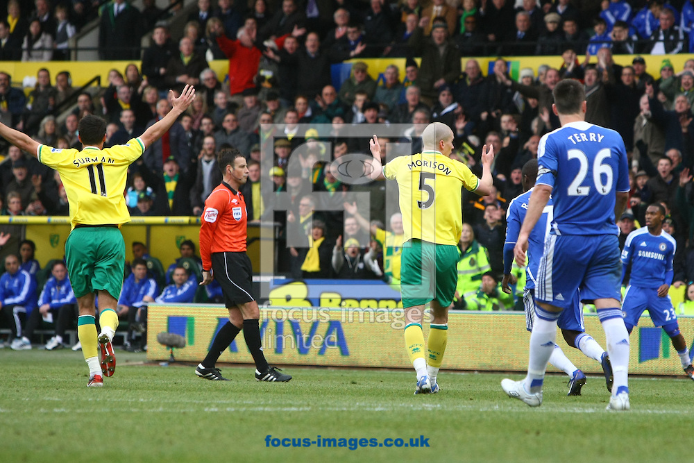 Picture by Paul Chesterton/Focus Images Ltd.  07904 640267.21/01/12.The Norwich players appeal to Referee Mark Clattenburg for handball during the Barclays Premier League match at Carrow Road Stadium, Norwich.
