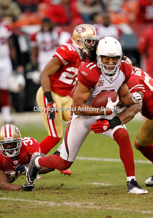 Arizona Cardinals wide receiver Larry Fitzgerald (11) gets tackled after a fourth quarter catch during the NFL week 17 football game against the San Francisco 49ers on Sunday, January 2, 2011 in San Francisco, California. The 49ers won the game 38-7. (©Paul Anthony Spinelli)