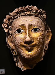 Mummy mask of a woman with plaited harr at the National Museum of Scotland in Edinburgh.