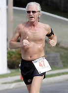 Middletown, New York - A runner competes in the Run4Downtown four-mile road race on Aug. 21, 2010.