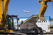 A DC-9 used for battling wildfires takes off during the demolition of the 757 on Wednesday. Boeing&rsquo;s facility is on the east side of the Grant County International Airport in Moses Lake. <br /> <br /> Mike Siegel/The Seattle Times
