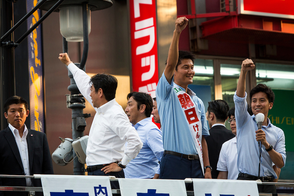TOKYO, JAPAN - JULY 03 : Japanese Prime Minister Shinzo Abe (Center), president of the ruling Liberal Democratic Party and Candidate Kentaro Asahi (Right), greets the voters during the July 10 Upper House election campaign in Shibuya crossing, Tokyo prefecture, Japan, on July 3, 2016. Photo: Richard Atrero de Guzman