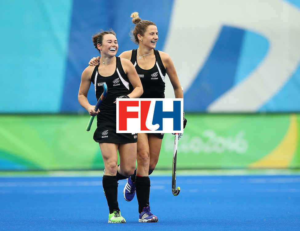 RIO DE JANEIRO, BRAZIL - AUGUST 10:  Kelsey Smith of New Zealand (L) celebrates with team mate Pippa Hayward as she scores their second goal during the Women's Pool A Match between Spain and New Zealand on Day 5 of the Rio 2016 Olympic Games at the Olympic Hockey Centre on August 10, 2016 in Rio de Janeiro, Brazil.  (Photo by Mark Kolbe/Getty Images)