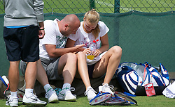 LONDON, ENGLAND - Friday, July 1, 2011: Petra Kvitova (CZE) shares a joke with her coach David Kotyza during a practice session ahead of her first Grand Slam Final match on day eleven of the Wimbledon Lawn Tennis Championships at the All England Lawn Tennis and Croquet Club. (Pic by David Rawcliffe/Propaganda)
