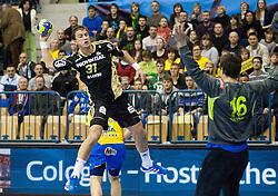 Momir Ilic  of Kiel vs Matevz Skok of Celje during handball match between RK Celje Pivovarna Lasko (SLO) and THW Kiel (GER) in 5th Round of Group B of EHF Champions League 2012/13 on November 17, 2012 in Arena Petrol, Celje, Slovenia. Triglav defeated Celje 2-1. (Photo By Vid Ponikvar / Sportida)