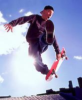 Skateboarding stunt --- Image by © Jim Cummins/CORBIS