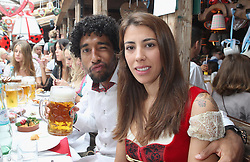 05.10.2014, Theresienwiese, München, GER, 1. FBL, FC Bayern Muenchen am Oktoberfest, im Bild Dante (L) of FC Bayern Muenchen and Joselina attend the Oktoberfest 2014 beer festival at Kaefers Wiesenschaenke at Theresienwiese on 2014/10/05. EXPA Pictures © 2014, PhotoCredit: EXPA/ Eibner-Pressefoto/ Pool<br /> <br /> *****ATTENTION - OUT of GER*****