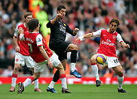 Photo: Tom Dulat/Sportsbeat Images.<br /> <br /> Arsenal v Manchester United. The FA Barclays Premiership. 03/11/2007.<br /> <br /> Tomas Rosicky(L) and Mathieu Flamini(R) of Arsenal and in between them Cristiano Ronaldo of Manchester United with the ball.