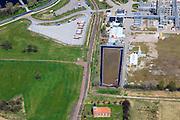 Nederland, Groningen, Delfzijl, 01-05-2013; Industrieterrein Eemsmondgebied met Chemie park. Het kerkje met dak van rode pannen is dat van het verdwenen dorpje Heveskes dat in het verleden ruimte moet maken voor het industrieterrein. Chemiepark.nl  huisvest onder andere AkzoNobel (soda, chloor, zout).<br /> Industrial Estate of the Eemsmond area with aluminum smelter Aldel (aluminum Delfzijl) right, to the left part of the Chemical Park. The little church with red roof tiles belongs to the village Heveskes, the village had to make room for the for the industrial park in the past Chemiepark.nl houses  Akzo Nobel (soda, chlorine, salt).<br /> luchtfoto (toeslag op standard tarieven);<br /> aerial photo (additional fee required);<br /> copyright foto/photo Siebe Swart