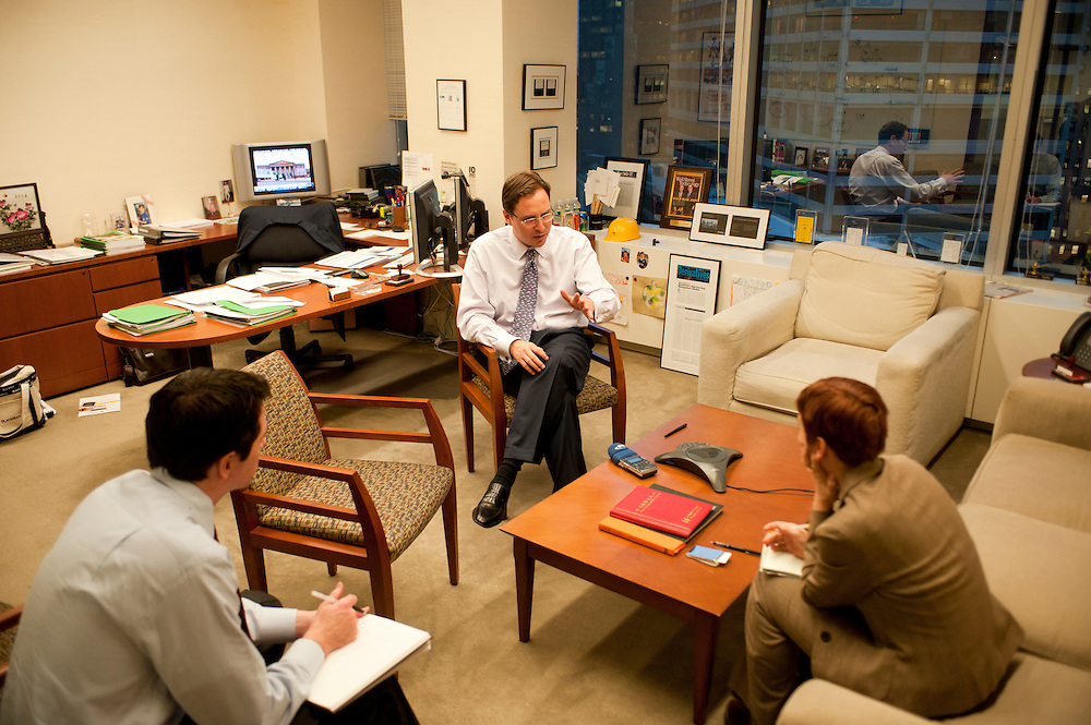 Rob Goldstein, Head of BlackRock Solutions, in his office. Left: director Brian Beades, right: Financial journalist Heike Buchter...BlackRock headquarters on 52nd street in Manhattan, New York City..Blackrock is the world's largest money managing company. According to Fortune magazine 'With more than $3 trillion in assets, Larry Fink and his team at BlackRock are the world's largest money managers'.