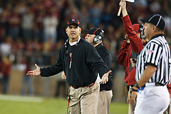 November 6, 2010; Stanford, CA, USA;  Stanford Cardinal head coach Jim Harbaugh argues a call during the second quarter against the Arizona Wildcats at Stanford Stadium.