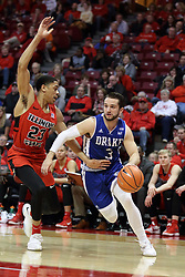 21 February 2018:  Graham Woodward heads to the hoop defended by William Tinsley during a College mens basketball game between the Drake Bulldogs and Illinois State Redbirds in Redbird Arena, Normal IL