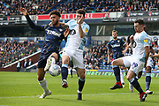 Leeds United forward Tyler Roberts (11) and Blackburn Rovers midfielder Richard Smallwood (6) during the EFL Sky Bet Championship match between Blackburn Rovers and Leeds United at Ewood Park, Blackburn, England on 20 October 2018.