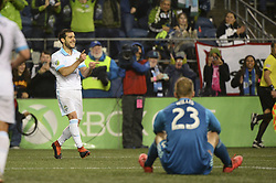 October 8, 2018 - Seattle, Washington, U.S - Seattle's VICTOR RODRIGUEZ (8) celebrates his late 2nd half goal as Houston keeper JOE WILLIS (23) looks on. The Houston Dynamo visited the Seattle Sounders in a MLS match at Century Link Field in Seattle, WA. Seattle won the match 4-1. (Credit Image: © Jeff Halstead/ZUMA Wire)