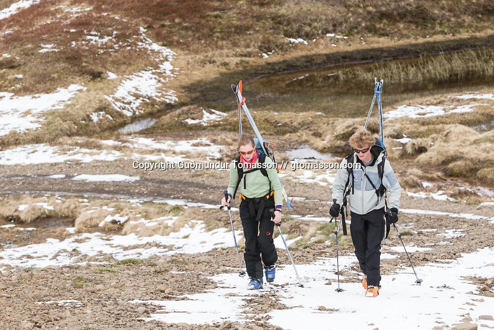 Jökull Bergmann and Sunna Björk Bragadóttir ascending mt. Lambárhnjúkur 1027m. Hvalvatnsfjörður, Iceland.