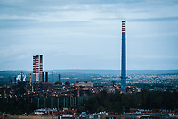 TARANTO, ITALY - 22 FEBRUARY 2018: The ILVA steel mill is seen here from Tamburi, the adjacent working-class district, in Taranto, Italy, on February 22nd 2018.<br /> <br /> Taranto, a  formerly lovely town on the Ionian Sea has for the last several decades been dominated by the ILVA steel mill, the largest steel plant in Europe. It was built by the government in the 1960s as a means of delivering jobs to the economically depressed south, but has been implicated for a cancer as dioxin and mercury have seeped into local groundwater, tainting the food supply, while poisoning the bay and its once-lucrative mussels.