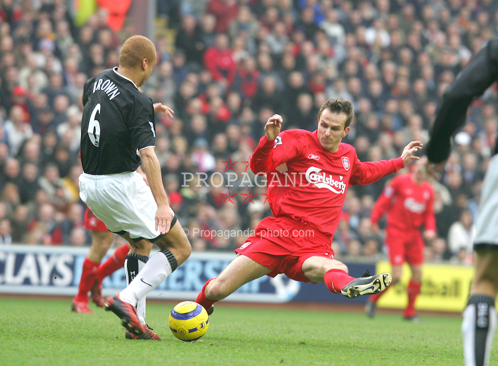 LIVERPOOL, ENGLAND - SATURDAY JANUARY 15th 2005: Liverpool's Dietmar Hamann and Manchester United's Wes Brown during the Premiership match at Anfield. (Pic by David Rawcliffe/Propaganda)