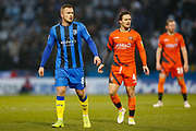 Gillingham midfielder Dean Parrett (8) and Wycombe Wanderers midfielder Dominic Gape (4) during the EFL Sky Bet League 1 match between Gillingham and Wycombe Wanderers at the MEMS Priestfield Stadium, Gillingham, England on 15 December 2018.