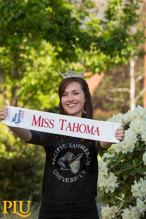 Kalina Springer '17, with her Miss Tahoma sash and crown will be competing in Miss Washington in June posing for photos at PLU on Wednesday, April 20, 2016. (Photo: John Froschauer/PLU)