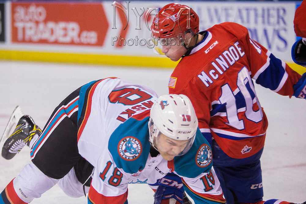 KELOWNA, CANADA - FEBRUARY 17:  Carsen Twarynski #18 of the Kelowna Rockets & Ethan McIndoe #10 of the Spokane Chiefs at the Kelowna Rockets game on February 17, 2017 at Prospera Place in Kelowna, British Columbia, Canada.  (Photo By Cindy Rogers/Nyasa Photography,  *** Local Caption ***