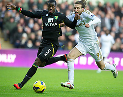 08.12.2012, Liberty Stadion, Swansea, ENG, Premier League, Swansea City vs Norwich City, 16. Runde, im Bild Swansea City's Miguel Perez Cuesta 'Michu' in action against Norwich City's Sebastien Bassong during the English Premier League 16th round match between Swansea City AFC and Norwich City FC at the Liberty Stadium, Swansea, Great Britain on 2012/12/08. EXPA Pictures © 2012, PhotoCredit: EXPA/ Propagandaphoto/ David Rawcliffe..***** ATTENTION - OUT OF ENG, GBR, UK *****