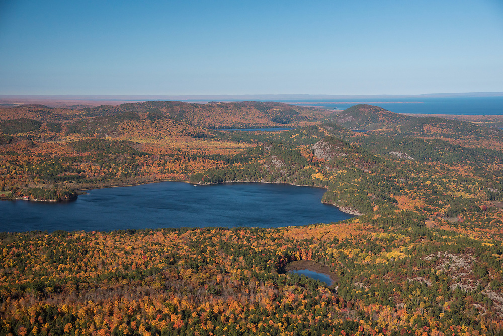 Aerial photography of the Huron Mountains near Big Bay, Michigan during fall color season.