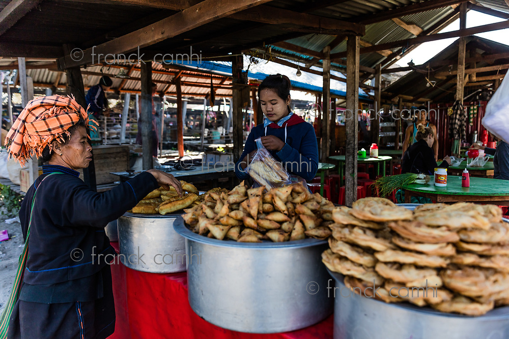 INLE LAKE, MYANMAR - DECEMBER 09, 2016 : people tribe working at the five days market at the Inle Lake Shan state in Myanmar (Burma)