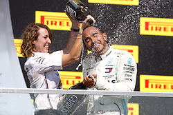 June 9, 2019, Montreal, Canada: Motorsports: British driver LEWIS HAMILTON is doused with champagne by Mercedes AMG Trackside Power Unit Engineer MARGA TORRES on the podium after Hamilton won the Formula One Grand Prix of Canada. (Credit Image: © Hoch Zwei via ZUMA Wire)