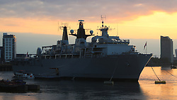 © Licensed to London News Pictures. 31/05/2014. HMS Bulwark pictured at Greenwich in south east London at dusk last night (30th May). The flagship of the Royal Navy is in London to help mark the 350th anniversary of the Royal Marines. Special uplighters have been threaded around the ship to make her look attractive after sunset. Credit : Rob Powell/LNP