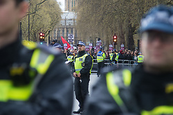 London, April 1st 2017. Police keep a wide 'sterile area' between opposing anti-fascist and nationalist protesters from the anti-Islamic group Britain First demonstrate in London following the Westminster terror attack of March 22nd.