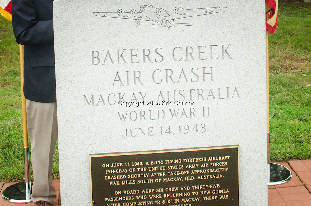 A group photo is taken during a ceremony marking 71th anniversary of a crash that killed 40 Army Air Corps members at Bakers Creek, Australia at Joint Base Myer-Henderson Hall in Arlington, Va. on June 13, 2014. Photo by Kris Connor