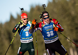 Arnd Peiffer (GER) and Dominik Landertinger (AUT) in action during the Men 10km Sprint at day 6 of IBU Biathlon World Cup 2018/19 Pokljuka, on December 7, 2018 in Rudno polje, Pokljuka, Pokljuka, Slovenia. Photo by Vid Ponikvar / Sportida