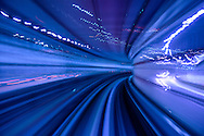 Blue light trail through railway tunnel