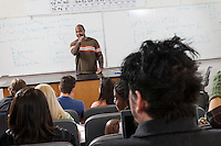 Lecturer teaching University students in classroom